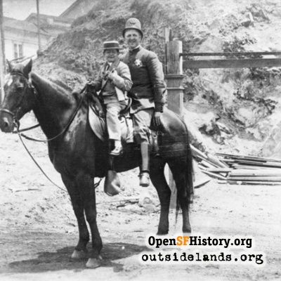 Point Lobos Ave. Mounted policemen with boy across from Cliff House.