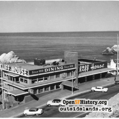 Third Cliff House and autos on Point Lobos Blvd.