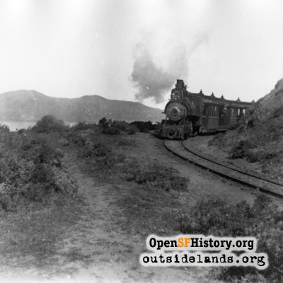 Ferries & Cliff House Railroad. Train rounding Lands End turn