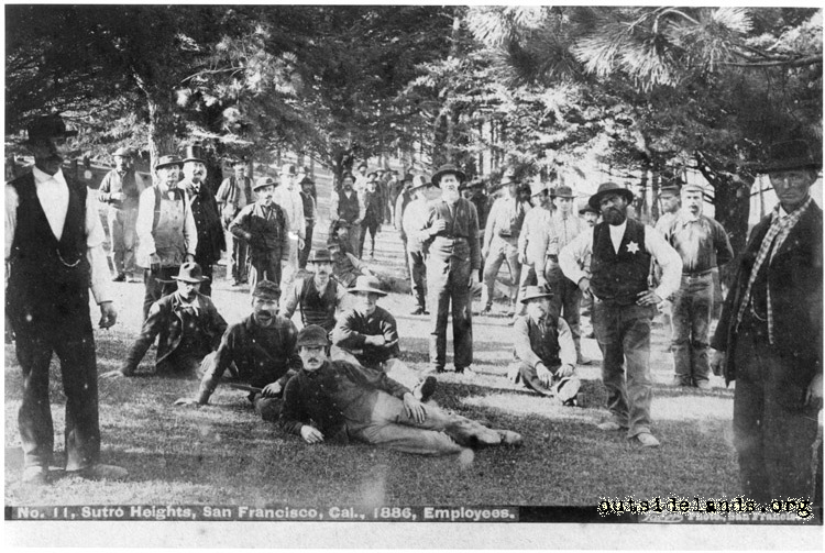 Sutro Heights. Adolph Sutro posing with employees standing on lawn in Old Grove