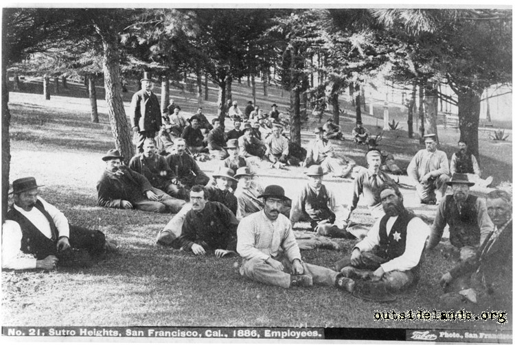 Sutro Heights. Adolph Sutro posing with seated employees on lawn in Old Grove