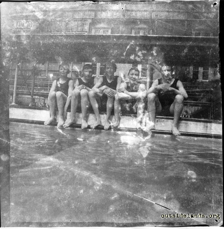 Sutro Baths. Boys seated on edge of pool