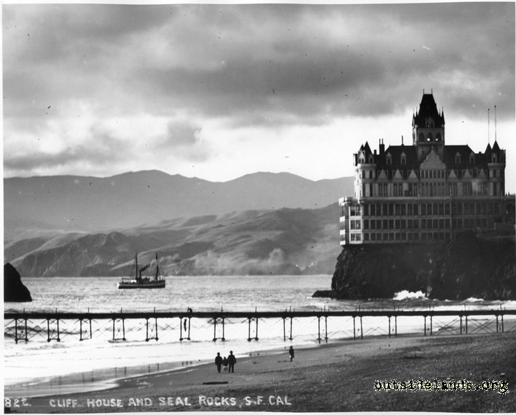Second Cliff House from Ocean Beach. Lurline Pier and steamship in middle distance