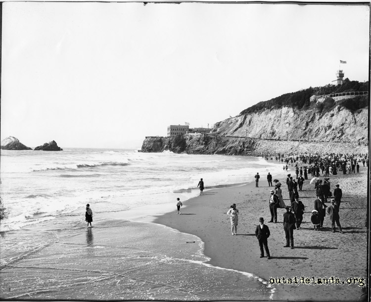 Ocean Beach. Visitors lining shore as children play in surf