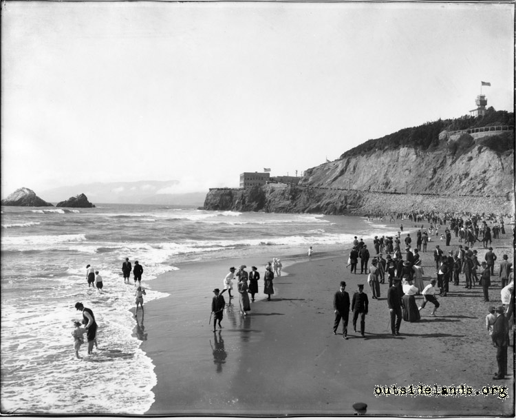 Ocean Beach. Visitors lining the shore and wading in surf