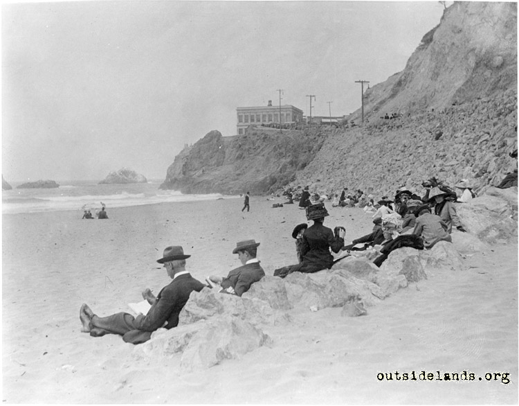 Ocean Beach. Visitors sitting on rocks near Point Lobos Ave.