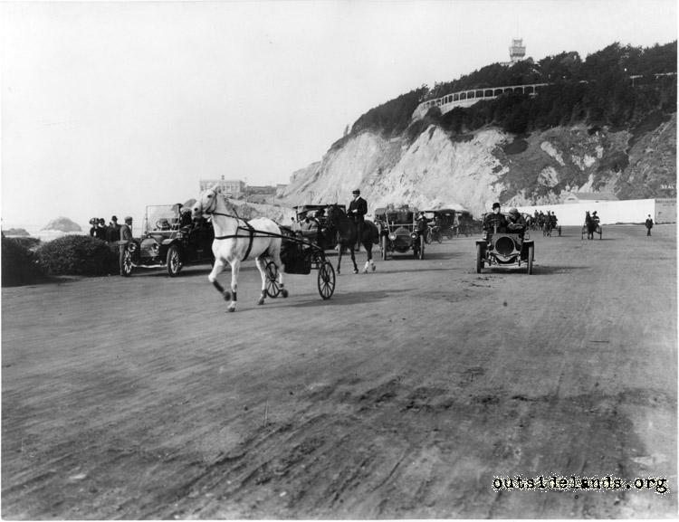 Ocean Beach. Horse drawn buggy, equestrian, and early autos near Balboa St.