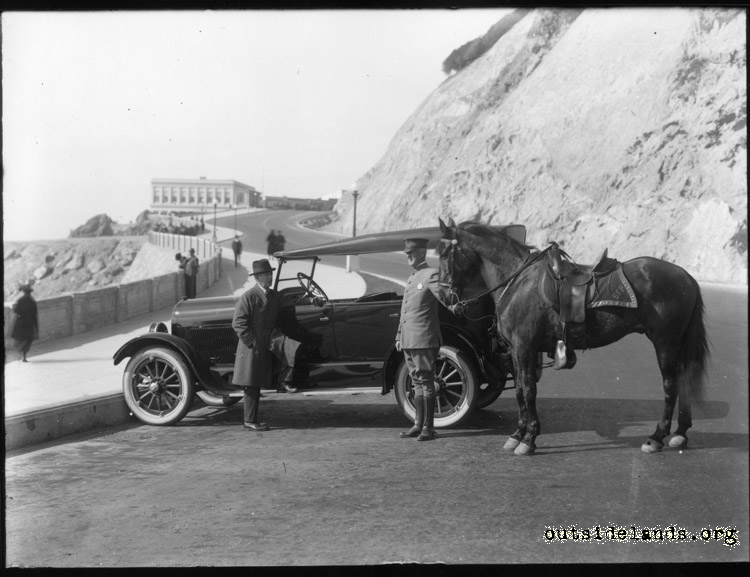 Point Lobos Ave. Auto and mounted policeman near Cliff House