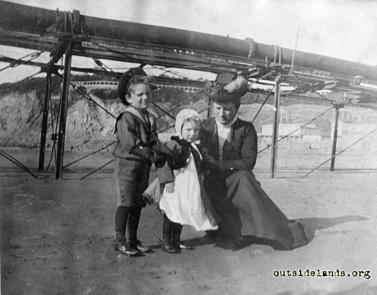 Ocean Beach. Woman and two children posing next to Lurline Pier