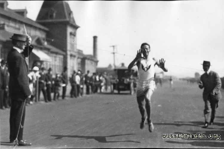 Great Highway. Olympic Club runner passing Ocean Beach Pavilion.