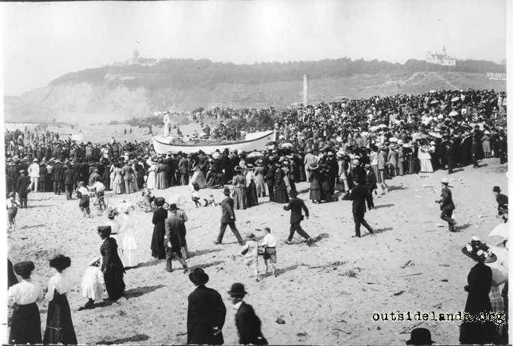 Ocean Beach. Crowds watching Life Saving Service lifeboat crossing beach